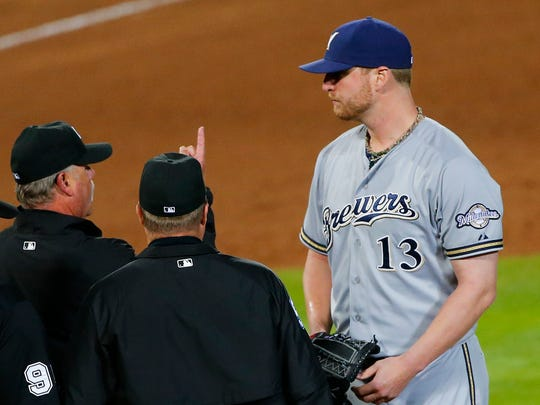 Milwaukee Brewers relief pitcher Will Smith is ejected during the seventh inning against the Atlanta Braves for allegedly using a foreign substance on Thursday, May 21, 2015, in Atlanta.