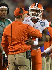 Clemson head coach Dabo Swinney and quarterback Deshaun Watson (4) during the 1st quarter of the ACC Championship at Camping World Stadium in Orlando on Saturday, December 3, 2016.