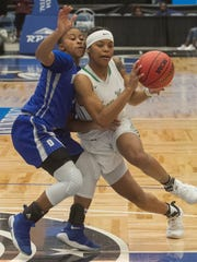 Fort Myers High School's Destanni Henderson (3) drives towards the basket as Dillard High School's Briah Christia (4) tries to defend during the first half of their FHSAA Girls 7A Semifinal game at The RP Funding Center in Lakeland Friday.