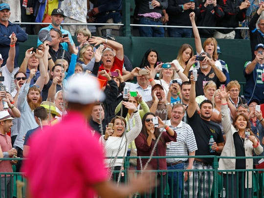 Fans cher for Tiger Woods at the 16th hole during the