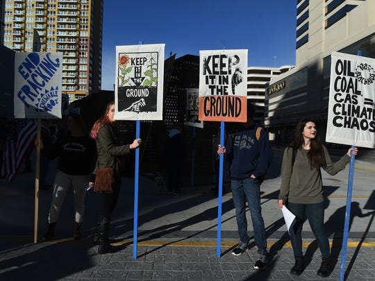 """Climate change activist stage a """"keep it in the ground"""" rally in downtown Reno on March 8, 2016. The activists gathered to protest the BLM's fossil fuel lease sale that would allow industry to bid on more than 50,000 acres of publicly owned oil and gas leases in Nevada."""