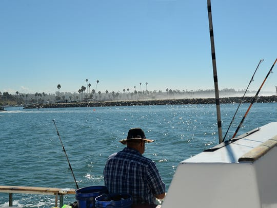 The fishing boat Electra motors past the breakwall near Oceanside, Calif., while heading out for a half-day of fishing.