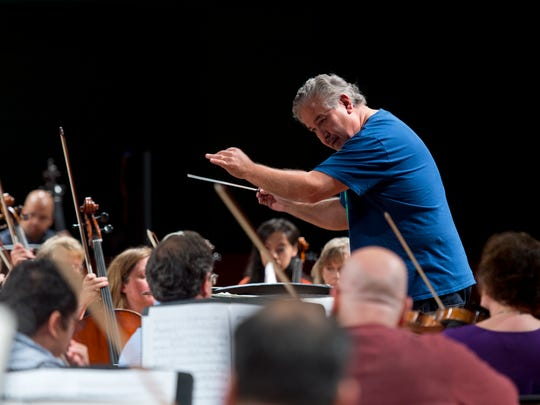 Corpus Christi Symphony guest conductor Hector Guzman practices for the first time with the orchestra at the Texas A&M Corpus Christi Performing Arts Center on Thursday, March 9, 2017.