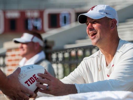 Alabama defensive coordinator Jeremy Pruitt signs autographs during fan day in Tuscaloosa, Ala. on Saturday August 5, 2017.