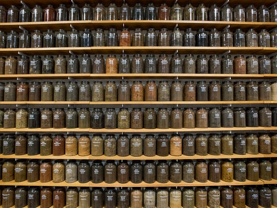 Jars of dirt collected from lynching sites across the United States are on display in Montgomery.