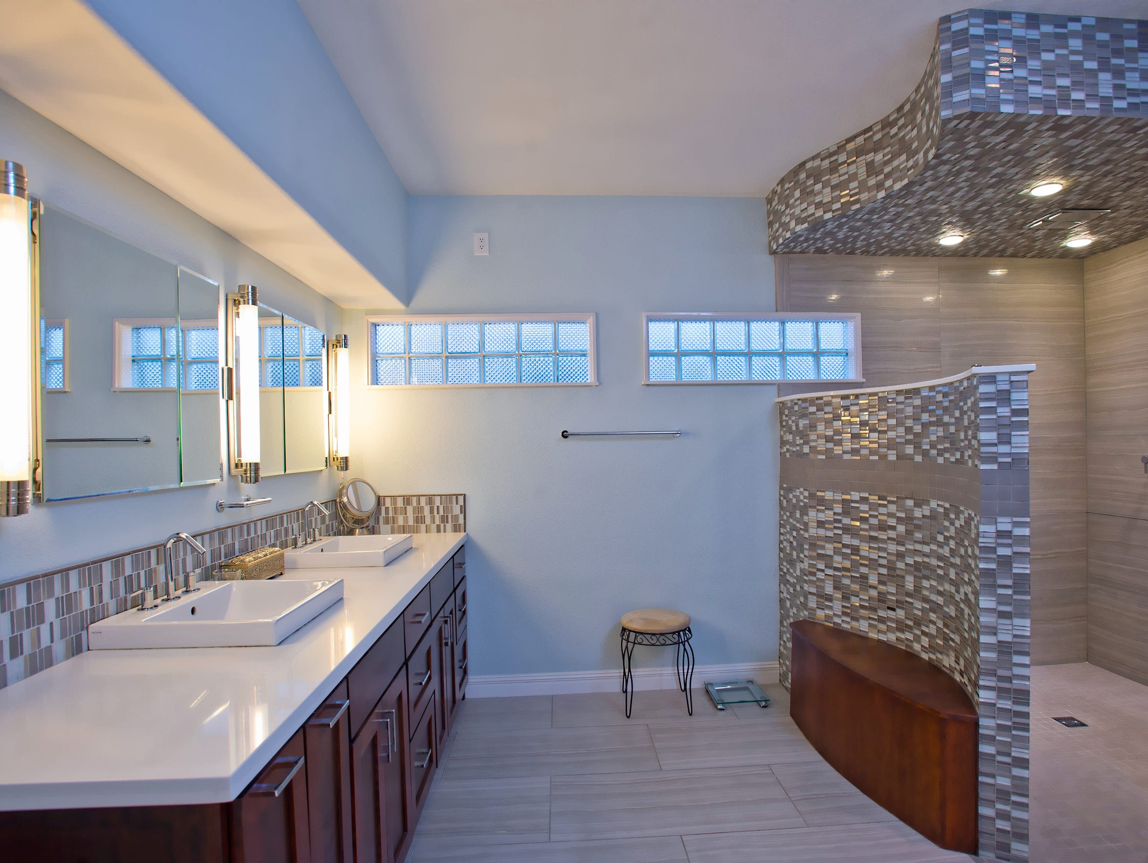 An amazing master bath features a huge rainfall shower