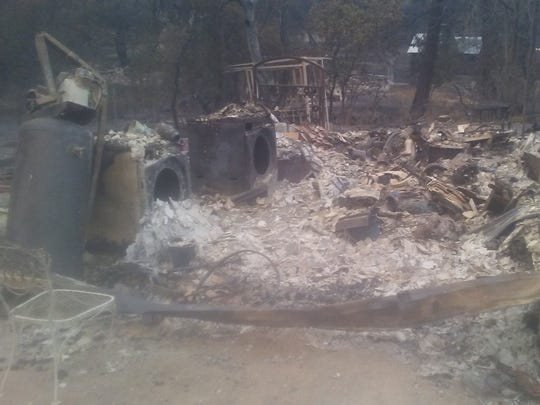 The husks of a washer and dryer can be seen amid the rubble at what was the home of Zook Richardson, before his house was destroyed by the Carr Fire in Northern California.