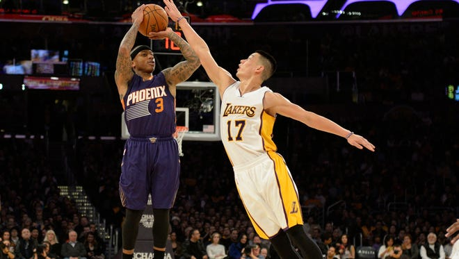 Los Angeles Lakers guard Jeremy Lin (17) defends against Phoenix Suns guard Isaiah Thomas (3) during the first half at Staples Center in Los Angeles on Dec.. 28