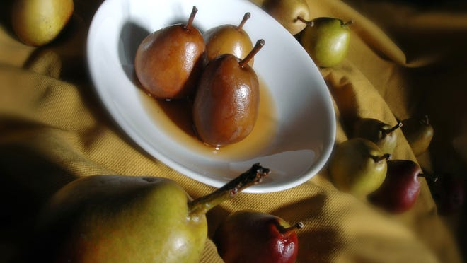 Staff photographer Carlos Ortiz took this photo of poached pears in the Democrat and Chronicle studio, but natural light can be just as effective.