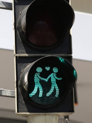 A new traffic light in Vienna shows a same-sex couple.