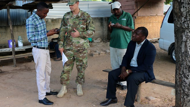 U.S. Army 1st Lt. Joe Todd, transportation manager for exercise Eastern Accord 2016, discusses the morning transportation schedule with a group of contracted local national drivers in Dar es Salaam, Tanzania.
