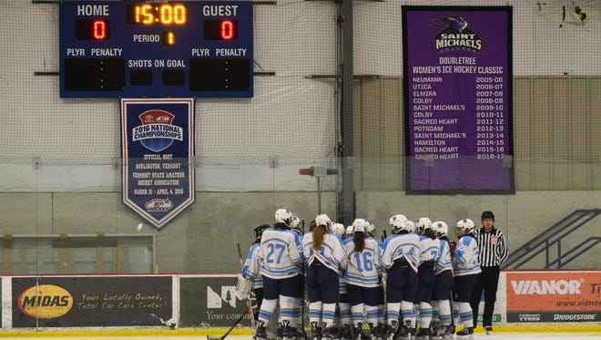South Burlington huddles together during the girls hockey game between the Hartford Hurricanes and the South Burlington Wolves at Cairns on Saturday night February 3, 2018 in South Burlington.