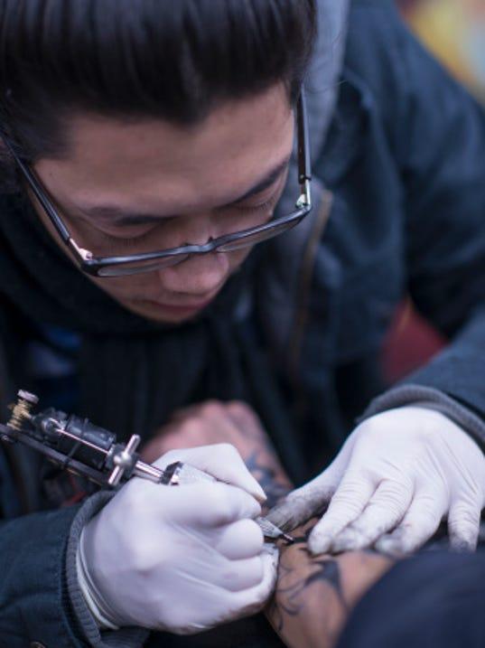 Michigan tattoo studio hosts animal benefit for Tattoo artists kalamazoo mi