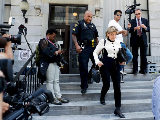 Attorney Gloria Allred walks down the steps of the