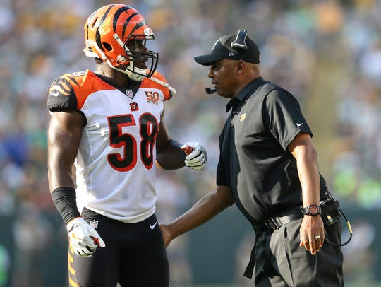Cincinnati Bengals head coach Marvin Lewis talks to