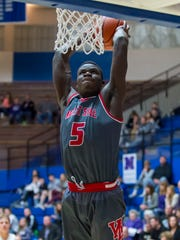 Nelson Mbongo throws down a signature dunk to seal West Lafayette's sectional championship victory over Northwestern this past March.