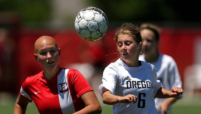 Pulaski forward Sami Barlament (19) and Oregon midfielder Taylor Martin (6) battle for the ball in the first half in Friday's WIAA Div. 2 semifinal game during the state soccer tournament at Uihlein Soccer Park in Milwaukee.