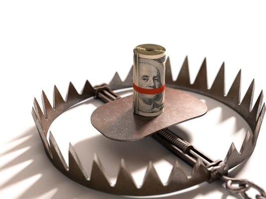 roll-of-hundred-dollar-bills-in-middle-of-bear-trap-money-cash-scam-scheme-fraud-risk_large.jpg