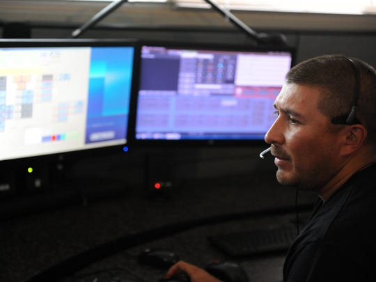 Dispatcher Aurio Esparza is intent on a call at Monterey County Emergency Communications in Salinas.