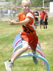 Troy Ward runs a lap on an obstacle course set up at