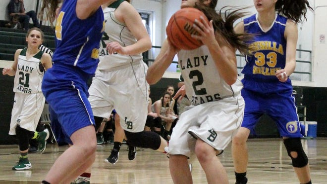 Cloudcroft's Ella Puckett, center, tries to score in the paint Saturday afternoon.