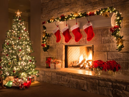 Glowing Christmas fireplace and living room, with tree,
