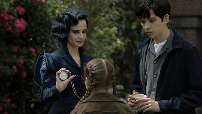"""Miss Peregrine (left, Eva Green) demonstrates one of her many time-bending talents to Jake (Asa Butterfield) and Fiona (Georgia Pemberton) in the film """"Miss Peregrine's Home for Peculiar Children."""""""