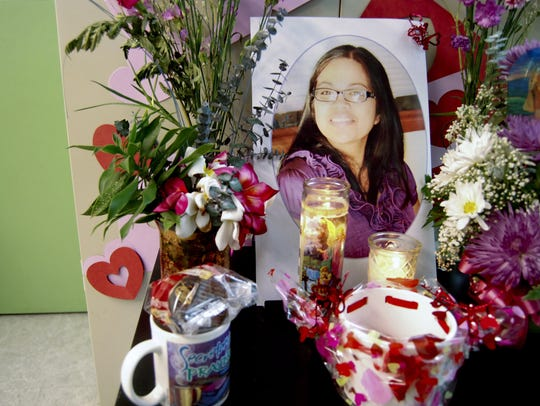 In this February 2013 file photo, flowers and other