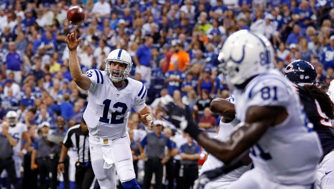 Indianapolis Colts quarterback Andrew Luck (12) throws a pass to wide receiver Andre Johnson (81) for a 2-point conversion against the Chicago Bears during the first half of an NFL preseason football game in Indianapolis, Saturday, Aug. 22, 2015. (AP Photo/Sam Riche)