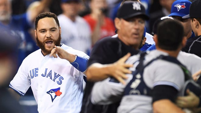 Toronto Blue Jays' Russell Martin trades words with New York Yankees' catcher Gary Sanchez during a bench-clearing melee in the second inning of a baseball game Monday, Sept. 26, 2016, in Toronto.