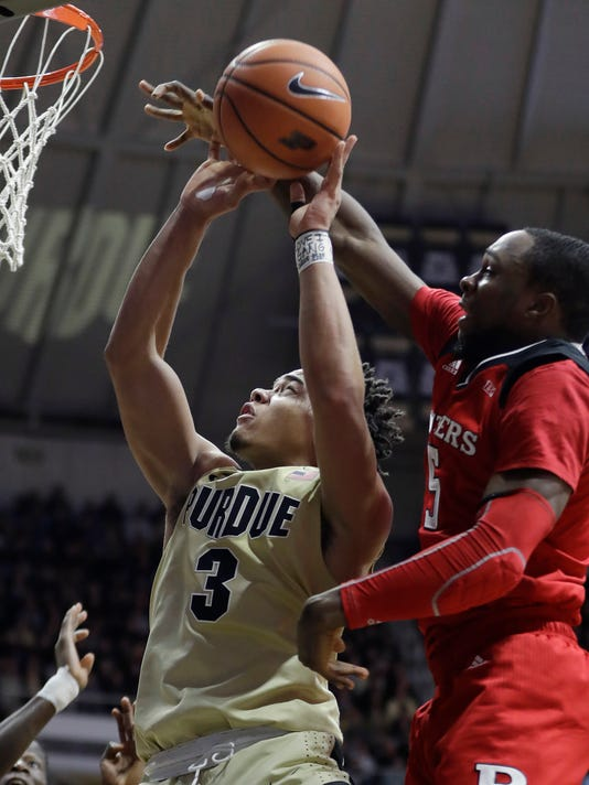 Purdue's Carsen Edwards shoots in front of Rutgers' Mike Williams during the second half of an NCAA college basketball game Wednesday, Jan. 3, 2018, in West Lafayette, Ind. Purdue won 82-51. (AP Photo/Darron Cummings)