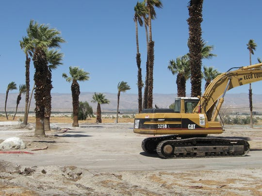 An excavator sits on the property that was once home to the Palm Springs Country Club clubhouse. It was demolished in June 2011.