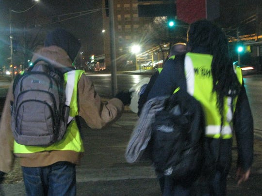 Rev. Kenneth McKoy, right, and Darius Butts walk on Kingshighway Blvd. in north St. Louis. The two regularly walk through some of St. Louis impoverished and crime-ridden neighborhoods handing out food and blankets to heroin addicts.
