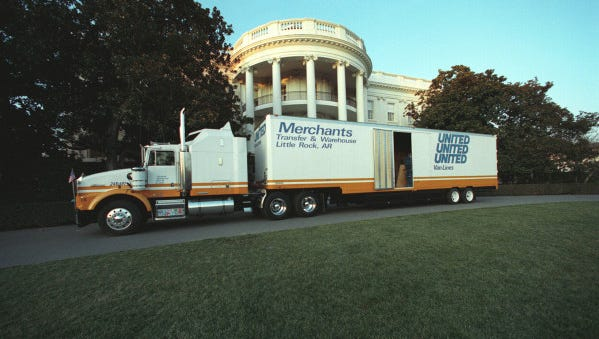 A moving van with the Clintons' belongings parks near the South Portico of the White House on the day of Bill Clinton's inauguration Jan. 20, 1993.