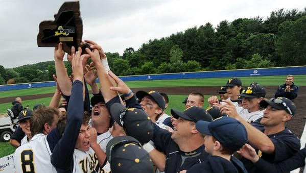 Victor players hoist the 2014 Class AA state championship plaque.