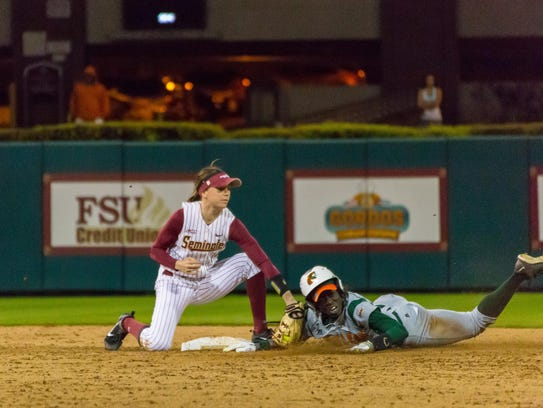 Ellie Cooper (14) tags out a runner trying to steal