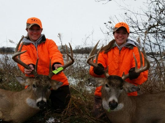 Twins Cayley, left, and Cassidy Vande Berg display the bucks they shot on opening day of deer hunting season.
