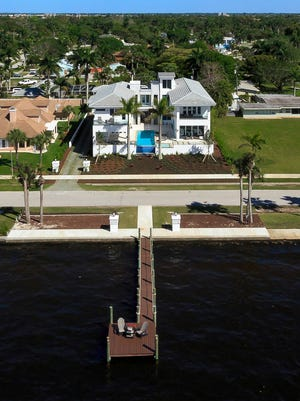 The Fort Myers riverfront home of David and Monique Fry.