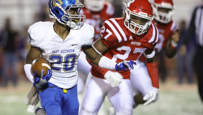 """East Ascension's Ralph Williams (20) runs unphased past a group of Bearcat defenders during Friday night's playoff game at L.J. """"Hoss"""" Garrett Stadium in Ruston, La."""