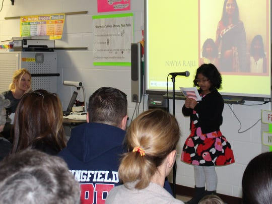 As part of a multi-week immigration project, Woodland 3rd grader Navya Raju talks about her mom who came to the U.S. from India at the age of 22, as teacher Amanda McGrath (L) looks on with a smile