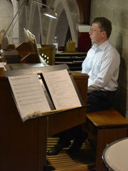 Guest organist the Rev. Bryan Gerlach plays in the refurbished balcony during the dedication service Sunday for the remodeled St. Paul Lutheran Church in Green Bay.