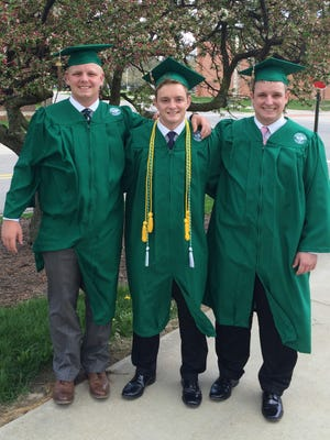 Matt, Jake and Chris Smith from Midland pose in their caps and gowns at Michigan State University on Thursday, May 5, 2016. The triplets graduate Saturday, May 7, 2016