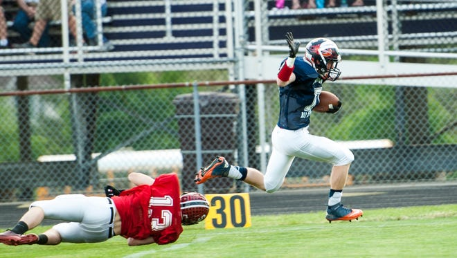 South receiver Jacob Fryer of Galion breaks free for a 70-yard touchdown in Saturday's 28-19 victory over the North in the 30th annual NCO All-Star Football Classic at Lexington High School.