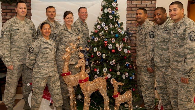The First Sergeant Council at Holloman Air Force Base gathers around the Diamond Tree located in the Base Exchange, Nov. 24. Every year, the First Sergeant Council collects and distributes gifts for Holloman children living in single and low income homes.