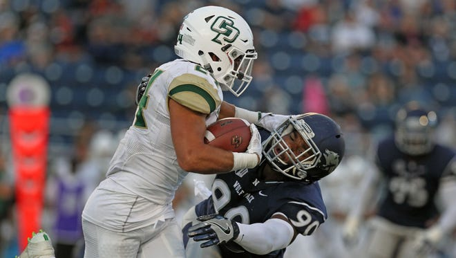 Wolf Pack defensive lineman Malik Reed tries to complete a tackle against Cal Poly running back Kori Garcia earlier this season.