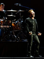 U2 lead singer Bono and drummer Larry Mullen Jr., perform