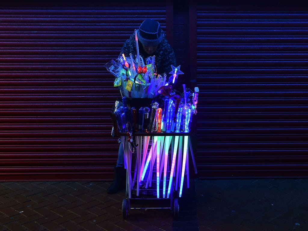 A street vendor sells novelty items during the Blackpool Illuminations event on Oct. 19 in Blackpool, England. The illumination event, which uses one million light bulbs, began in 1879 as local seaside resorts attempted to extend the holiday season f
