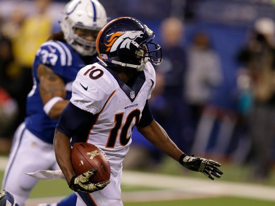 Denver Broncos wide receiver Emmanuel Sanders (10) makes a 64-yard touchdown reception during the second half of an NFL football game against the Indianapolis Colts, Sunday, Nov. 8, 2015, Indianapolis.