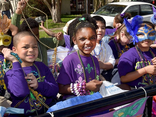 Beads, beads and more beads tossed by the students of Park Vista Elementary as they rode in the school's annual Mardi Gras parade Friday afternoon.