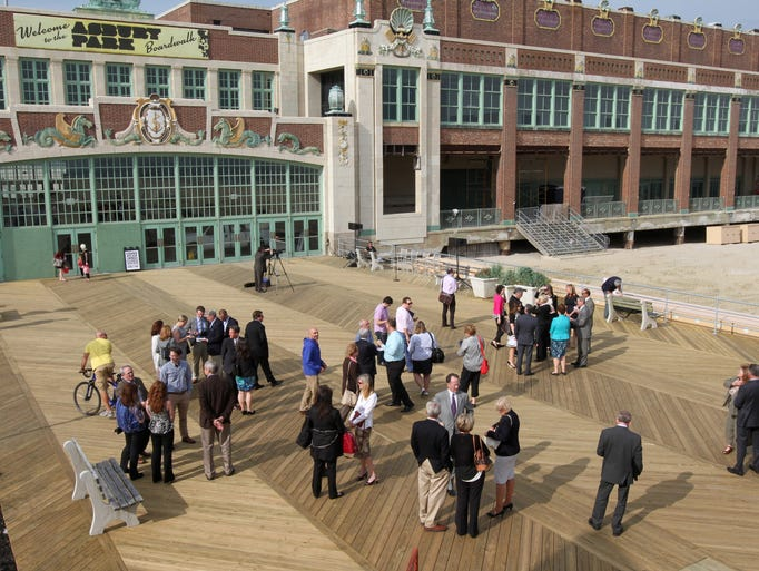 Crowd gathers on the boardwalk in Asbury Park before the start of the Summer Kick-Off  Press Conference and Legislative Reception. Wednesday  May , 21, 2014, Asbury Park. Photo by Robert Ward